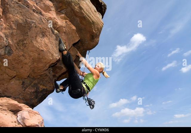 Young woman climbing an extreme rock - Charlotte Frank at the Windstein - Vosges - France - Stock Image