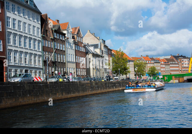 Copenhagen Denmark cruise along canals Nyhavn Kobenhavn tourists - Stock Image