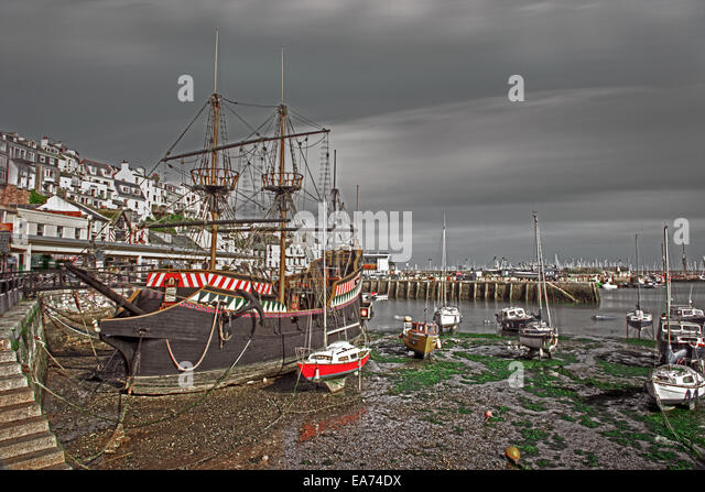 Golden Hind ship, replica and fishing boats in empty harbour at  Brixham, Torbay,Devon, England, UK. - Stock Image
