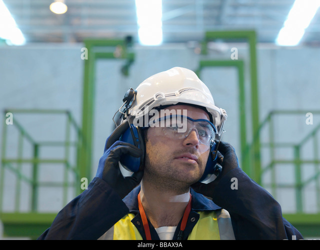 Worker With Protective Clothing - Stock Image