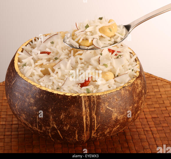 POLYNESIAN COCONUT RICE WITH SPOON - Stock Image