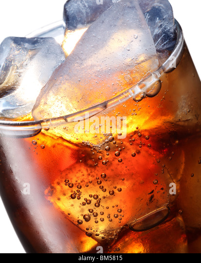 Glass of cola with ice cubes - Stock Image