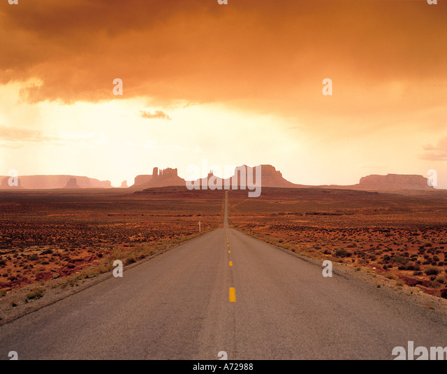 Road in Monument Valley and Interstate 163 in Arizona - Stock Image