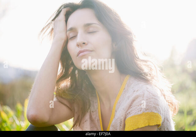 Beautiful woman day dreaming - Stock Image