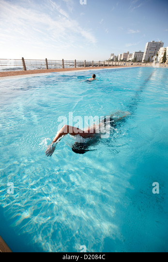 Swimmer in public pool Sea Point, Atlantic Seaboard, Cape Town, South Africa, Africa - Stock Image