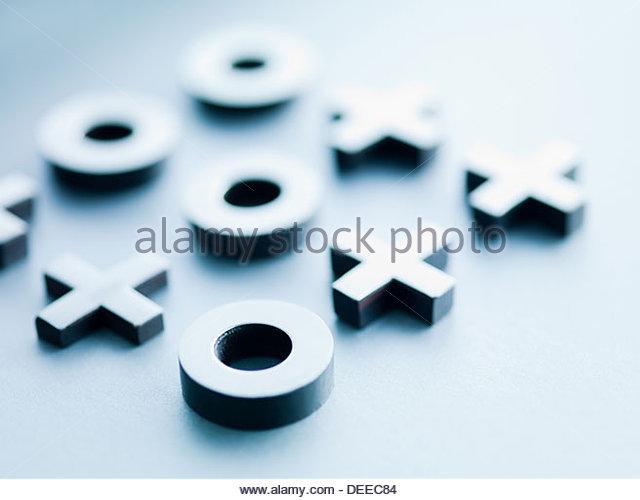 Metal tic-tac-toe game pieces - Stock Image