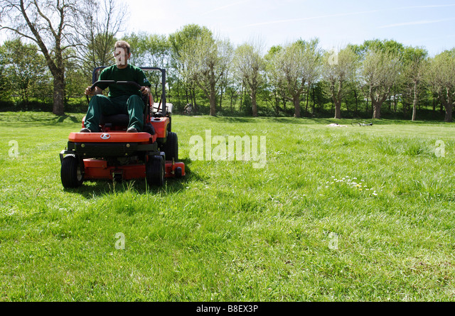 Man On Tractor Lawn Enforcment : Man on ride lawnmower stock photos