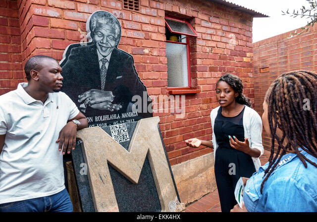 Johannesburg South Africa African Soweto Vilakazi Street Precinct Nelson Mandela home museum outside Black woman - Stock Image