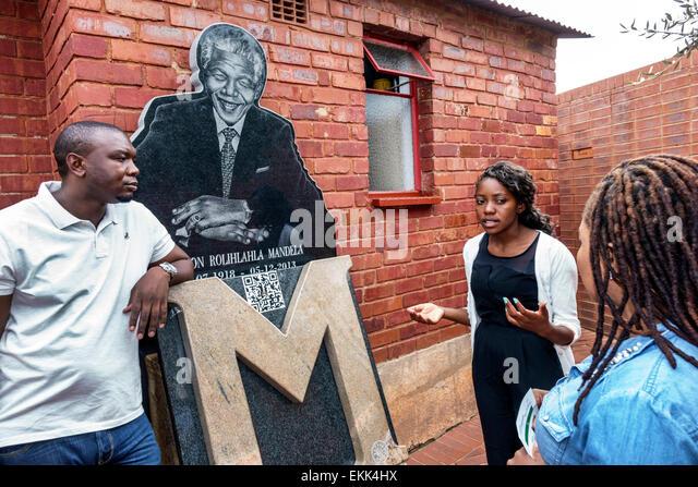 South Africa African Johannesburg Soweto Vilakazi Street Precinct Nelson Mandela home museum outside Black woman - Stock Image