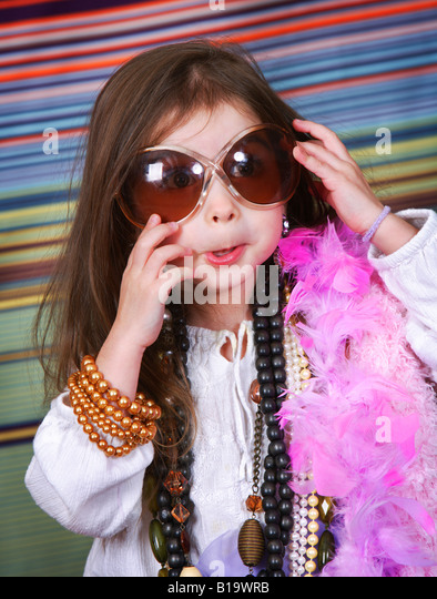 Girl in dress up clothes - Stock Image