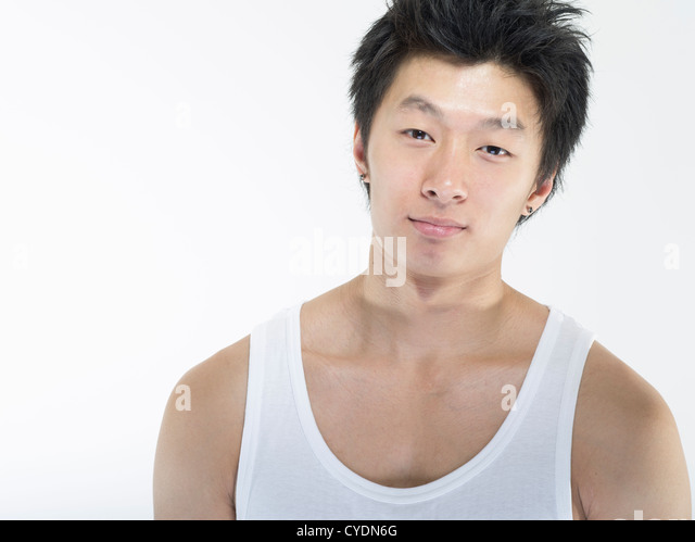 Young handsome muscular Asian male on white background - Stock Image