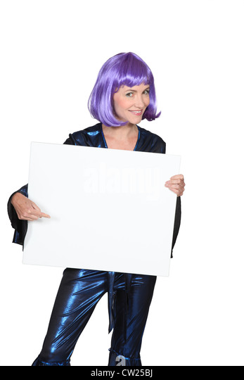 Woman in a purple wig with a board left blank for your message - Stock Image