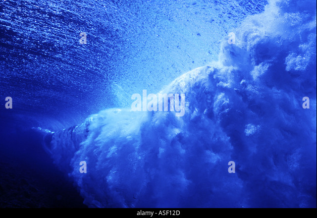 Underwater view of large wave surf breaking on coral reef Fiji - Stock Image