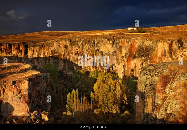 Cappadocia, Aksaray, Turkey. The entrance of Ihlara Valley under heavy, cloudy sk - Stock Image