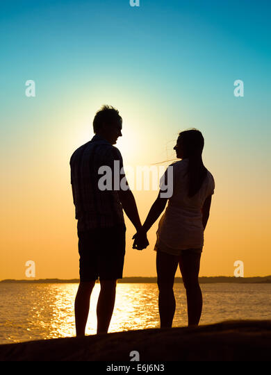 In love young couple enjoying the sunset together, beautiful evening in archipelago - Stock-Bilder