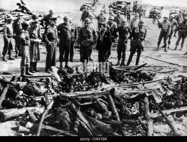 General Dwight D. Eisenhower (third left), General Omar Bradley, General George C. Patton viewing the bodies of - Stock Image