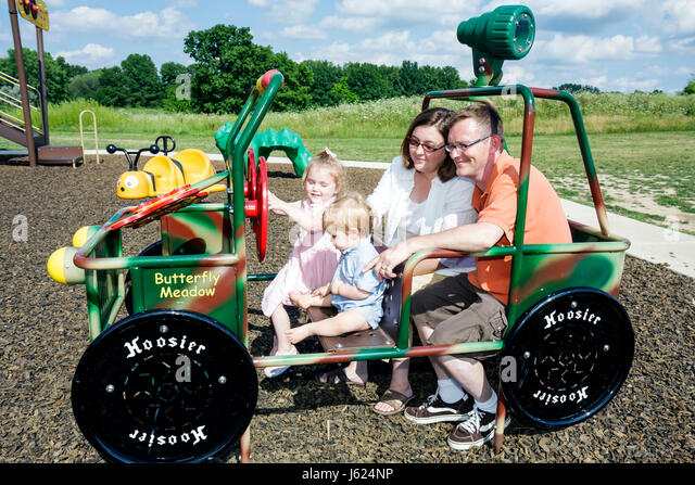 Indiana Valparaiso Butterfly Meadow theme playground scale jeep man woman boy girl baby preschooler family mother - Stock Image