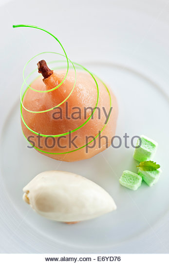 Poached pear with almond stuffing,marshmallows and lemon balm ice cream - Stock Image