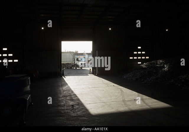 Truck driving into recycling depot - Stock Image