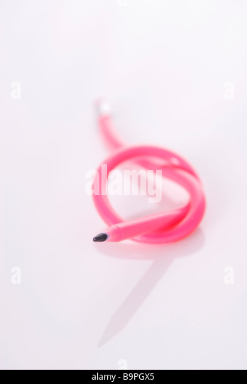Colourful flexible pencil with a knot on a white background - Stock Image