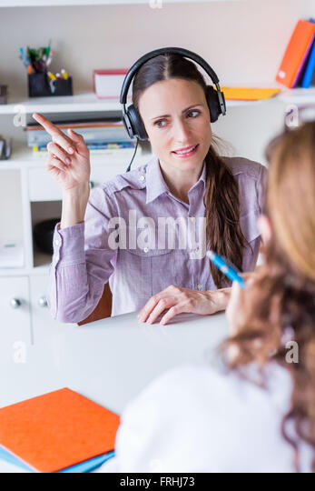 Woman undergoing pure-tone audiometry test. - Stock Image