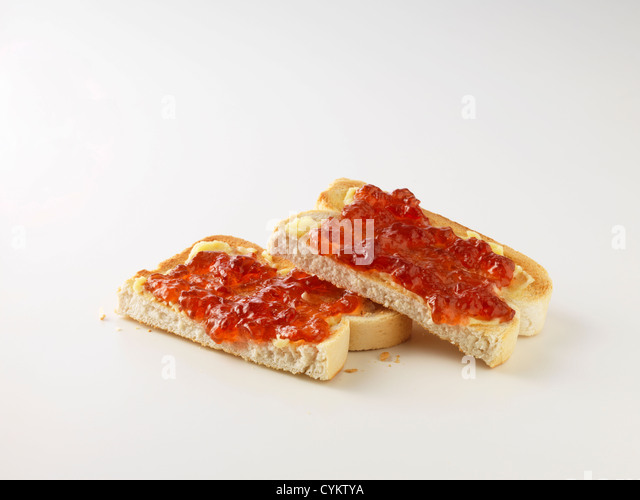 Toast with butter and jam - Stock Image