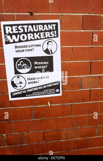 a notice on a wall is aimed at restaurant workers, who may be being exploited - Stock-Bilder