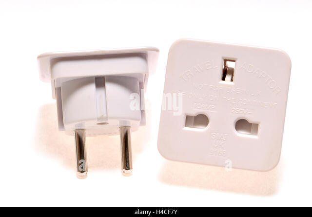 Travel plug adapter - for using a three pin UK plug in a two pin European socket - Stock-Bilder