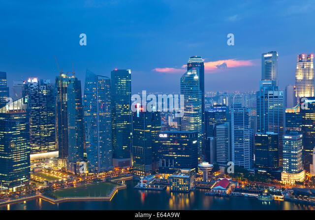 Singapore skyline at dusk, Singapore, SE Asia - Stock Image