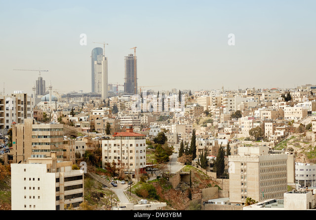 Amman city view of buildings and new skyscrapers. Amman the capital of Jordan spreads on seven hills - Stock Image