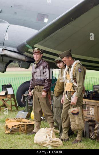 American Flight crew standing next to a WW11 Douglas C-47 Skytrain - Stock Image