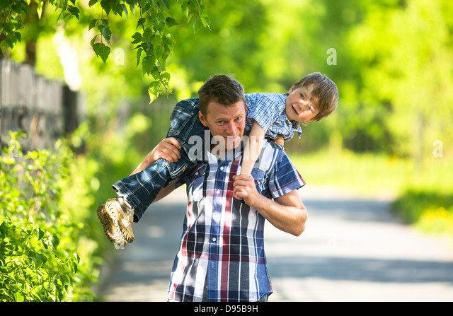 Father and son playing in the park - Stock Image