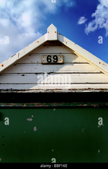 A single hut alomg the beach in dorset with a number 69 - Stock-Bilder