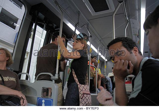 Maryland Baltimore Charm City Circulator public transportation bus free shuttle stop eco-friendly passenger man - Stock Image