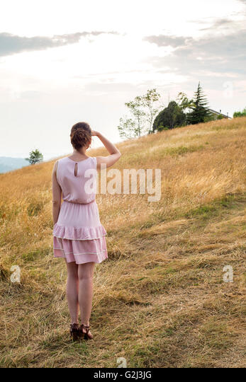 Girl And Cat Looking Off Into Distance