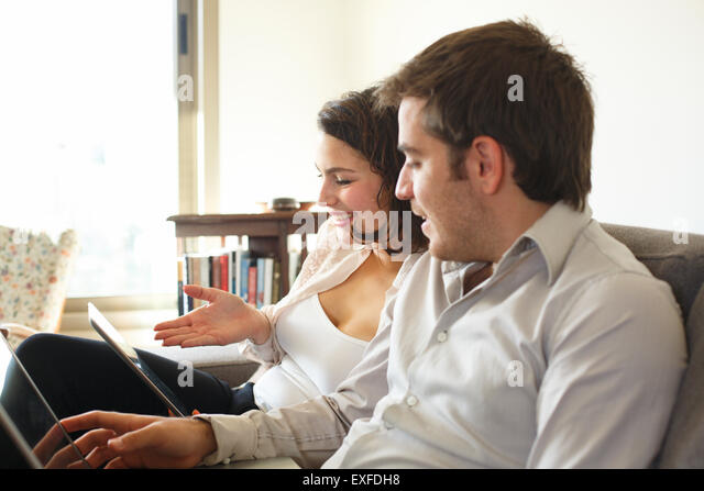 Couple surfing the web at home - Stock Image