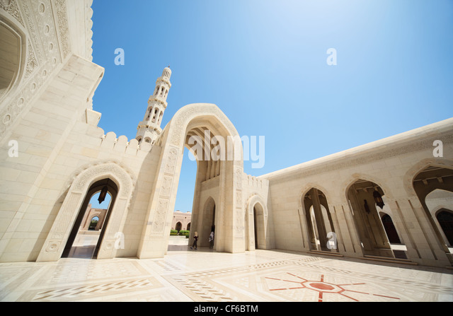 beautiful architecture inside Grand Mosque in Oman. arcs, tower. - Stock Image