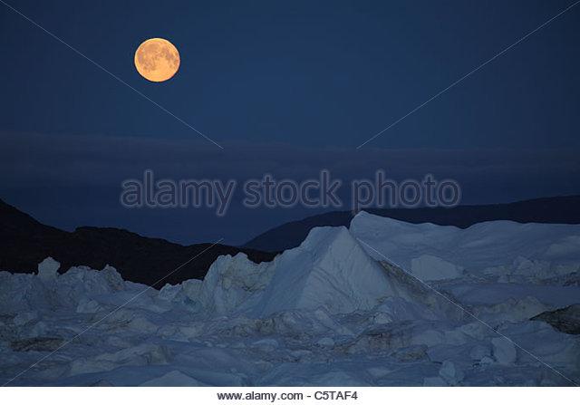 West Greenland, Ilulissat, Iceberg with full moon - Stock Image