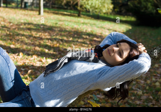 Girl relaxing in the sunshine - Stock Image