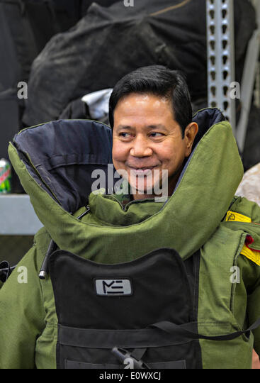 Royal Thai Armed Forces Lt. Gen. Krisda Norapoompipat wears an advanced bomb suit during a visit to Camp Hansen - Stock Image