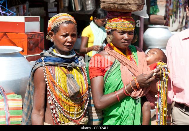 Two Bonda tribeswoman and baby in traditional bead costume, Rayagader, Orissa, India - Stock Image