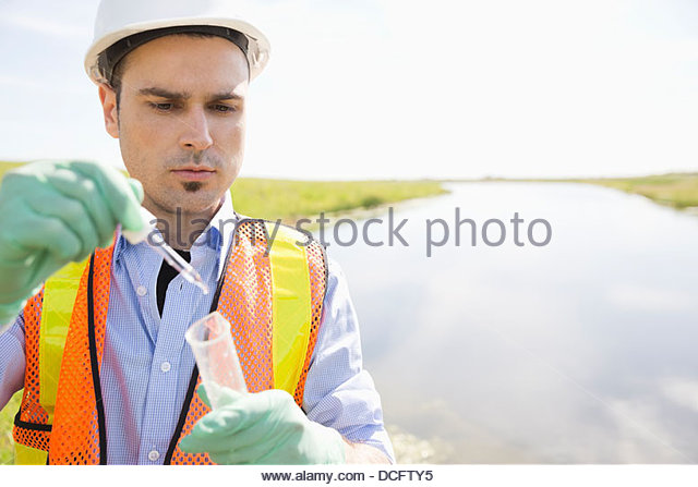 Ecologist testing water samples - Stock Image