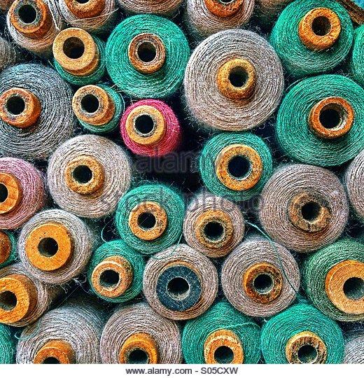 Vintage thread bobbins - Stock Image