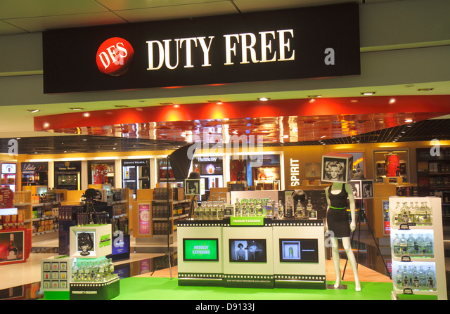 Singapore Changi International Airport SIN terminal concourse gate area shopping retail display for sale DFS duty - Stock Image