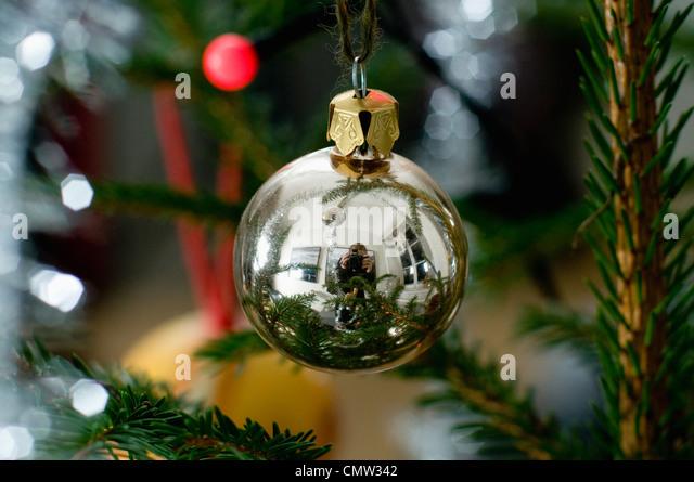 Reflection of photographer on Christmas ball - Stock Image