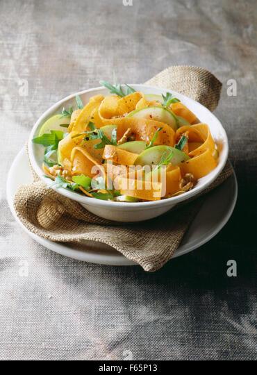 pumpkin, apple, rocket and walnut salad - Stock Image