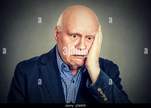 portrait of elderly desperate sad man - Stock Image