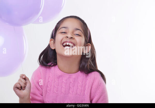 Portrait of a little girl with balloons - Stock-Bilder