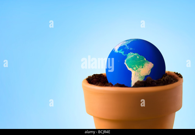 Planet earth in a flower pot - Stock Image