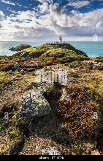 Strumble Head lighthouse in Pembrokeshire, Wales UK on a sunny autumn's day. - Stock Image